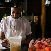 ASHEVILLE, NC - JUNE 29: Chef Ashleigh Shanti of Benne on Eagle, works on menu before dinner service at her restaurant on Eagle Street in Asheville, NC on Saturday June 29, 2019. (Photo by Logan Cyrus / The New York Times)