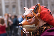 Protesters gather to deomontstrate against various issues outside the Bank of England in the heart of the City of London. Issues such as anti climate change, capitalism and those against the credit crisis were the main points of the day. Bankers being a particular target of protest. Elderly protester who is anti-hunting in a fox mask.