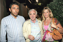 French singer Charles Aznavour, his daughter Katia and her husband attend Arielle Dombasle's concert during the 21st edition of the Festival de Ramatuelle, the annual theatre festival held in Ramatuelle, near Saint-Tropez, southern France on August 4, 2005. Photo by Benoit Pinguet/ABACAPRESS.COM