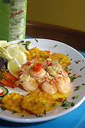 Mambo Cuban Cuisine: Tender cooked shrimp in garlic sauce with yellow rice and fried planntains.