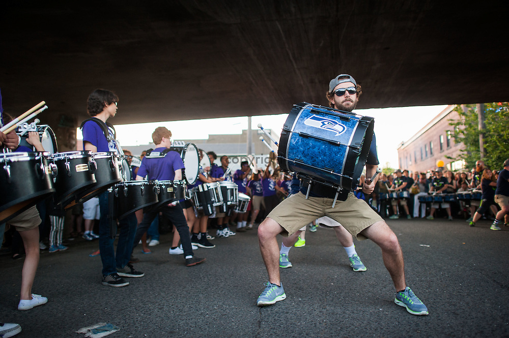 2014 June 20 - The Seattle Seahawks Blue Thunder drumline face off against the Garfield High School drumline under the overpass during Honk! Fest in Georgetown, Seattle, WA. By Richard Walker