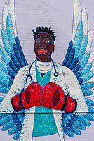Mural of an African Amefrican Doctor fighting the Coronavirus crisis (COVID-19) by artist Austin Zucchni-Fowler, Denver, Colorado USA.