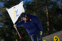 FIS's Flag carrier during Flying Hill Individual Qualifications at 1st day of FIS Ski Jumping World Cup Finals Planica 2012, on March 15, 2012, Planica, Slovenia. (Photo by Vid Ponikvar / Sportida.com)