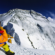 IMG Guide Chris Booher gazes at Everest's North Face from the 23,000 foot Camp IV at the North Col, Tibet.