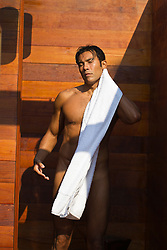 nude man toweling off in an outdoor shower