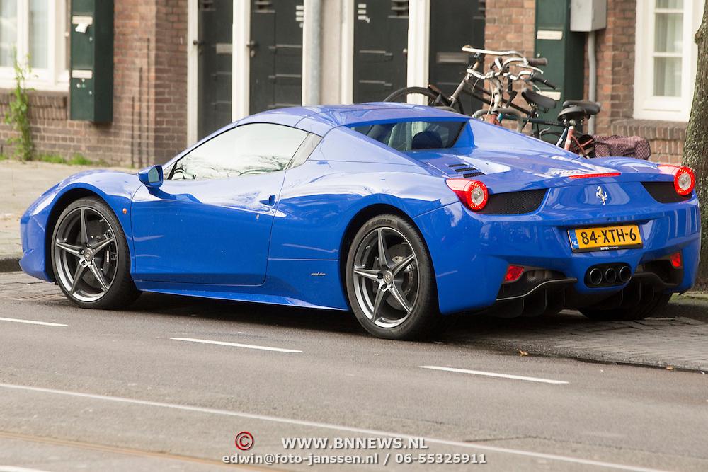 NLD/Amsterdam/20140201 - Maria Tailor rijdt in de Ferrari auto van Afrojack,