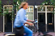 Cyclist in the Jordaan trendy district of Amsterdam, Holland