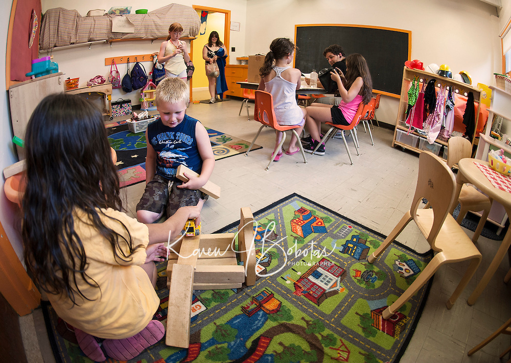 """Children enjoy exploring the rooms of the Boys and Girls Club of the Lakes Region as they begin their first week in their new """"home"""" on North Main Street in Laconia.  (Karen Bobotas/for the Laconia Daily Sun)"""