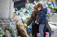 A mother and daughter lay flowers In memory of Prince Philip The Royal Highness the Duke of Edinburgh, London on 9 April 2021.