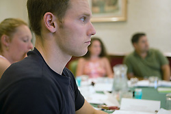 Youth Justice staff member listening to the teacher during training,