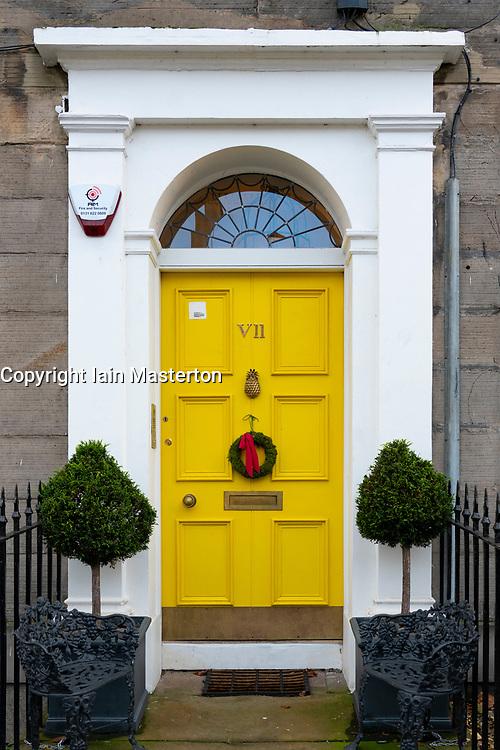Christmas Wreath off door of house in Edinburgh's New Town , Scotland, UK