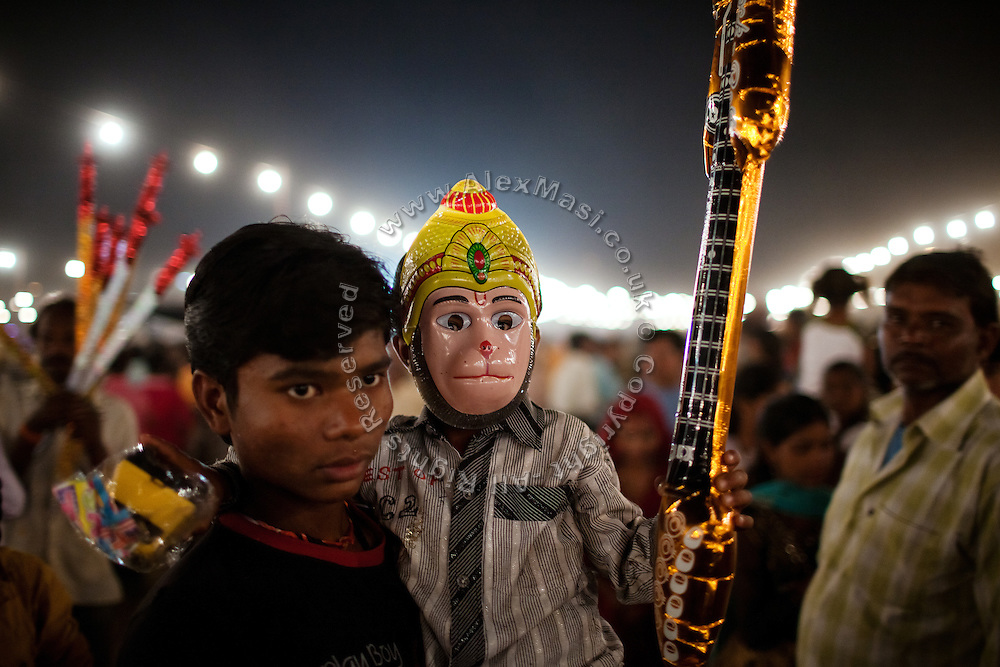 A child is wearing a Hanuman mask during the Dussehra Festival celebrations in Bhopal, Madhya Pradesh, India, site of the 1984 Union Carbide (now DOW Chemical) gas disaster.
