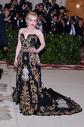 Emilia Clarke walking the red carpet at The Metropolitan Museum of Art Costume Institute Benefit celebrating the opening of Heavenly Bodies : Fashion and the Catholic Imagination held at The Metropolitan Museum of Art  in New York, NY, on May 7, 2018. (Photo by Anthony Behar/Sipa USA)