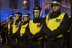 London, November 5th 2016. Anti-capitalists and anarchists participate in the Million Mask March, an annual event that happens on November 5th each year in cities across the world, as part of a protest against the establishment. Many of the protesters wear Guy Fawkes masks, often associated with the internet activism group Anonymous. PICTURED: Riot police block access to The Strand in order to contain the crowd.