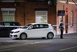© Licensed to London News Pictures. 26/07/2020. Manchester, UK. A car on the road , surrounded by police tape , off Henbury Street. A 17 year old boy has been stabbed to death and three others stabbed causing injuries , in the Moss Side area of South Manchester this evening. Photo credit: Joel Goodman/LNP