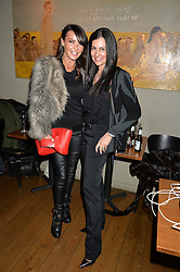 Left to right, LIZZIE CUNDY and KIMBERLEY COWELL at the 1st birthday of The House of Ho, 57-59 Old Compton Street, Soho, London on 22nd January 2015.
