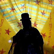 Cholita Carmen Rosa waits behind the curtain before her introduction to the ring during the 'Titans of the Ring' wrestling group performance at El Alto's Multifunctional Centre. Bolivia. The wrestling group includes the fighting Cholitas, a group of Indigenous Female Lucha Libra wrestlers who fight the men as well as each other for just a few dollars appearance money. El Alto, Bolivia, 17th January 2010. Photo Tim Clayton