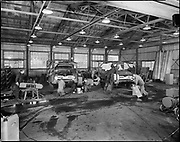 "Ackroyd 05923-1 ""Convoy Co. Interior of rear shop. March 14, 1955"" (showing conversion of 1955 Ford trucks to auto moving vehicles. 8x10"" neg) (Sandberg Manufacturing Co. 3850 NW Yeon ORBC Oregon Beverage Recycling Cooperative Convoy Co. 3900 NW Yeon DEQ site ID 4015)"