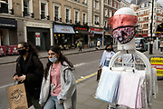 Face masks and visors are still being used by a large proportion of people as visitors come in to central London on 25th May 2021 in London, United Kingdom. As the coronavirus lockdown continues its process of easing restrictions, more and more people are coming to the West End as more businesses open.
