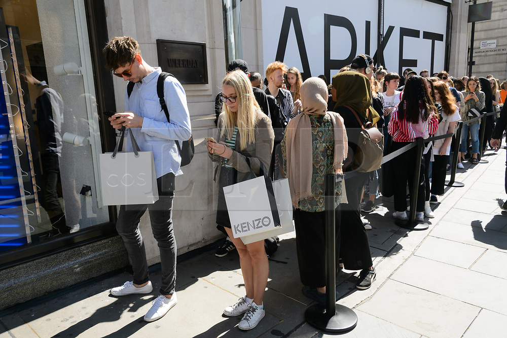 © Licensed to London News Pictures. 18/08/2017. London, UK. Customers queue outside for the opening of H&M group's first Weekday clothing store in Regent Street.  Weekday is know for its denizens offerings and minimalist styles, with 27 stores throughout Europe. Photo credit: Ray Tang/LNP