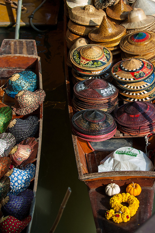 Hats for sale in the Floating Market at Damnoensaduak in Thailand. The hats are sold from canoes or row boats in the canals west of Bangkok.