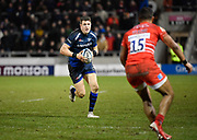 Sale Sharks centre Sam James runs at Leicester Tigers full back Telusa Veainu during a Gallagher Premiership Rugby Union match, Sale Sharks -V- Leicester Tigers, Friday, Feb. 21, 2020, in Eccles, United Kingdom. (Steve Flynn/Image of Sport via AP)