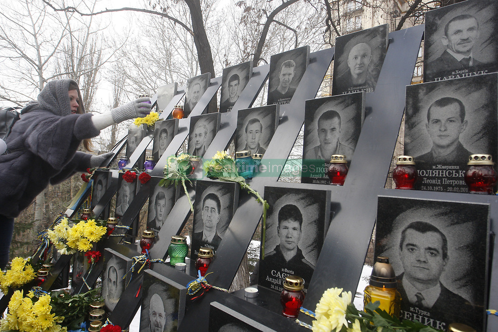 November 21, 2018 - Kiev, Ukraine - An Ukrainian woman places a candle at the memorial for the killed EuroMaidan activists during marking the 5th anniversary of the Euromaidan Revolution in Kiev, Ukraine, on 21 November 2018. Euromaidan Revolution or Revolution of Dignity was a wave of demonstrations and civil unrest in Ukraine, which began on the night of 21 November 2013 with public protests at Independence Square in Kiev, demanding European integration.The protests led to the 2013-2014 Ukrainian revolution and the ouster of President Viktor Yanukovych. (Credit Image: © Serg Glovny/ZUMA Wire)