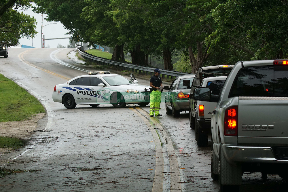 October 7, 2016 - Florida, U.S. - Police stop cars on Bridge Road leading to Jupiter Island on Hobe Sound on October 6, 2016. (Credit Image: © Richard Graulich/The Palm Beach Post via ZUMA Wire)