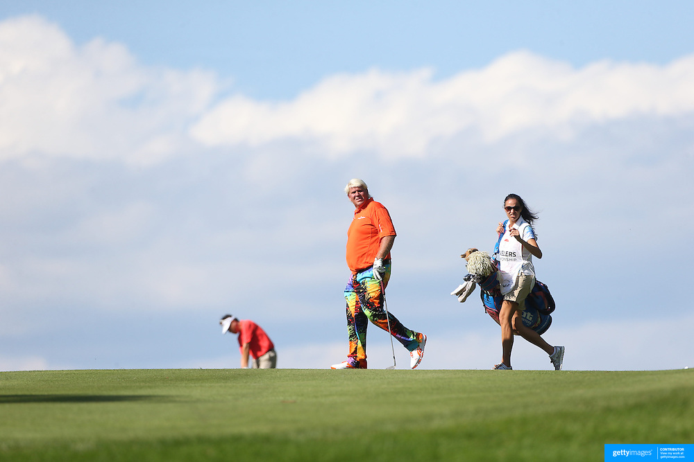 John Daly, USA and caddie, girlfriend Anna Cladakis, in action during the first round of the Travelers Championship at the TPC River Highlands, Cromwell, Connecticut, USA. 19th June 2014. Photo Tim Clayton