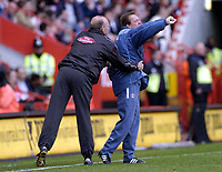 Photo: Olly Greenwood.<br />Charlton Athletic v Portsmouth. The Barclays Premiership. 17/04/2006. Charlton manager Alan Curbishley has to be restrained by the 4th official