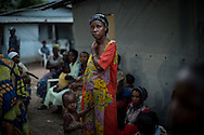 DRC / Burundi Refugees / A woman stands outside of a tent just before sunset in Kavimvira transit centre run<br /> by UNHCR in Uvira, DRC's South Kivu Province.<br /> 700 vulnerable Burundian refugees are hosted in Kavimvira transit centre. The<br /> majority are women and children.<br /> <br /> More than 9000 Burundians refugees have crossed into the DRC over the past few weeks. The new<br /> arrivals are being hosted by local families, but the growing numbers are straining<br /> available support. UNHCR is helping some 700 vulnerable refugees at a transit centre<br /> at Kavimvira and in another centre at Sange. Work is ongoing to identify a site<br /> where all the refugees can be moved, and from where they can have access to<br /> facilities such as schools, health centers and with proper security. / UNHCR / F.Scoppa / May 2015