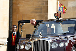 The Duke of Edinburgh arrives for the wedding of Princess Eugenie to Jack Brooksbank at St George's Chapel in Windsor Castle.