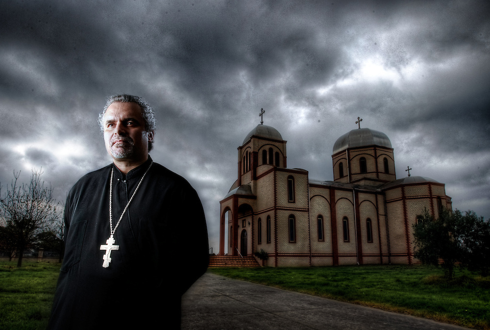 BEST VERSION: Father Milan Milutinovic, Serbian orthodox Church that had a molotov cocktail thrown threw the winow in June this year. Pic By Craig Sillitoe CSZ/The Sunday Age.19/8/2011 melbourne photographers, commercial photographers, industrial photographers, corporate photographer, architectural photographers, This photograph can be used for non commercial uses with attribution. Credit: Craig Sillitoe Photography / http://www.csillitoe.com<br /> <br /> It is protected under the Creative Commons Attribution-NonCommercial-ShareAlike 4.0 International License. To view a copy of this license, visit http://creativecommons.org/licenses/by-nc-sa/4.0/.