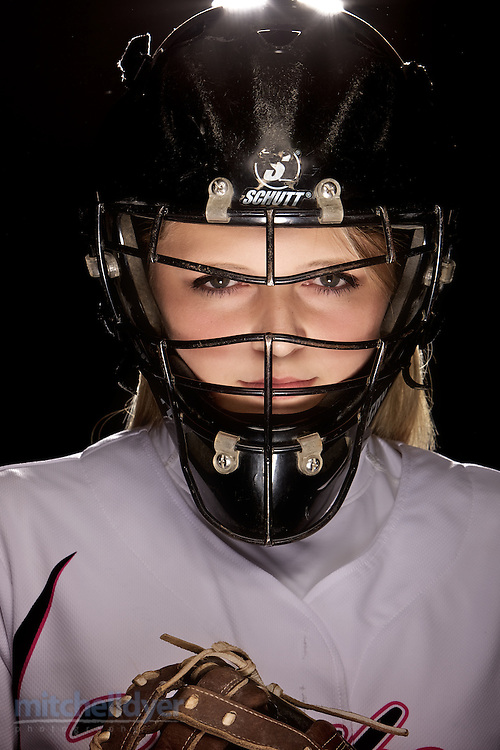 Softball catcher poses in Portland, OR