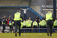 a line of Police officers hold fans back after full time. The Emirates FA Cup 5th round match, Millwall v Leicester City at The Den in London on Saturday 18th February 2017.<br /> pic by John Patrick Fletcher, Andrew Orchard sports photography.