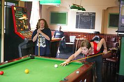 Playing a game of pool in a pub,