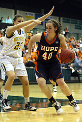19 March 2010: Meredith Kussmaul works toward the paint defended by Jodie Luther. The Flying Dutch of Hope College defeat the Yellowjackets of the University of Rochester in the semi-final round of the Division 3 Women's Basketball Championship by a score of 86-75 at the Shirk Center at Illinois Wesleyan in Bloomington Illinois.