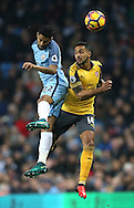 Gael Clichy of Manchester City tussles with Theo Walcott of Arsenal during the English Premier League match at the Etihad Stadium, Manchester. Picture date: December 18th, 2016. Picture credit should read: Simon Bellis/Sportimage