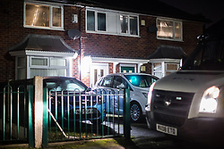 © Licensed to London News Pictures .  24/01/2018 . Manchester , UK . Police outside a house on Somerton Avenue in Wythenshawe where on the afternoon of Sunday 21 January 2018 police report being called by the ambulance service to reports that a 22-month-old girl was having a medical episode . This evening (January 24 2018) police have arrested a 34-year-old woman and a 28-year-old man on suspicion of murder in relation to the girl's death . Photo credit : Joel Goodman/LNP