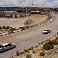 Traffic bumps over a damaged section of Jefferson Avenue in Gallup Friday.