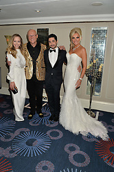 Left to right, TAMARA RALPH, JOHN CAUDWELL, MICHAEL RUSSO and CLAIRE CAUDWELL at The Butterfly Ball in aid of Caudwell Children held at the Grosvenor House, Park Lane, London on 25th June 2015