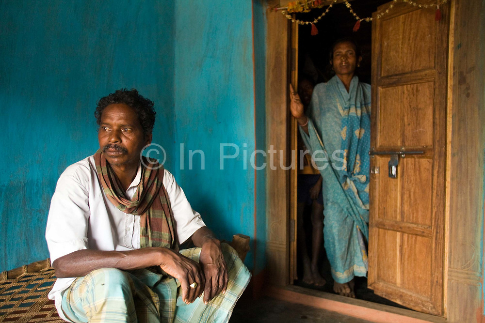 Dai Singh Majhi, a leader of the Niyamgiri Surakshya Samidi group in Belemba village, with his wife, Dipai, Orissa, India. The Dongria Kondh are a protected 'Scheduled' Caste of Original (aboriginal) people that practice animism and live a settled rural life. Their deity is a mountain from which a mining company, Vedanta is seeking to extract bauxite which will largely destroy the mountain and the Kondh's traditional way of life.