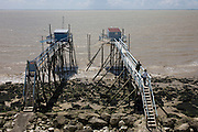 Fishing piers overlooking the river Gironde estuary at Talmont-sur-Gironde, Charente-Maritime, France.