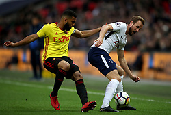 Watford's Adrian Mariappa (left) and Tottenham Hotspur's Harry Kane battle for the ball during the Premier League match at Wembley Stadium. London.