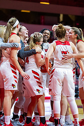 NORMAL, IL - November 20: Paige Saylor gets mobbed by her team after stealing the ball at the end of the game with just seconds left to seal the win for the 'Birds during a college women's basketball game between the ISU Redbirds and the Huskies of Northern Illinois November 20 2019 at Redbird Arena in Normal, IL. (Photo by Alan Look)