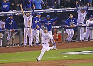 Kansas City Royals left fielder Alex Gordon (4) reacts after hitting a solo home run to tie the game against the New York Mets in the 9th inning in game one of the 2015 World Series at Kauffman Stadium.