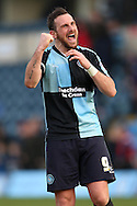 Paul Hayes , the Wycombe Wanderers captain celebrates towards the fans after the final whistle. Skybet football league two match, Wycombe Wanderers  v Stevenage Town at Adams Park  in High Wycombe, Buckinghamshire on Saturday 12th March 2016.<br /> pic by John Patrick Fletcher, Andrew Orchard sports photography.