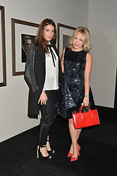 Left to right, GALA GORDON and POPPY JAMIE at the IWC Schaffhausen Gala Dinner in honour of the British Film Institute held at the Battersea Evolution, Battersea Park, London on 7th October 2014.