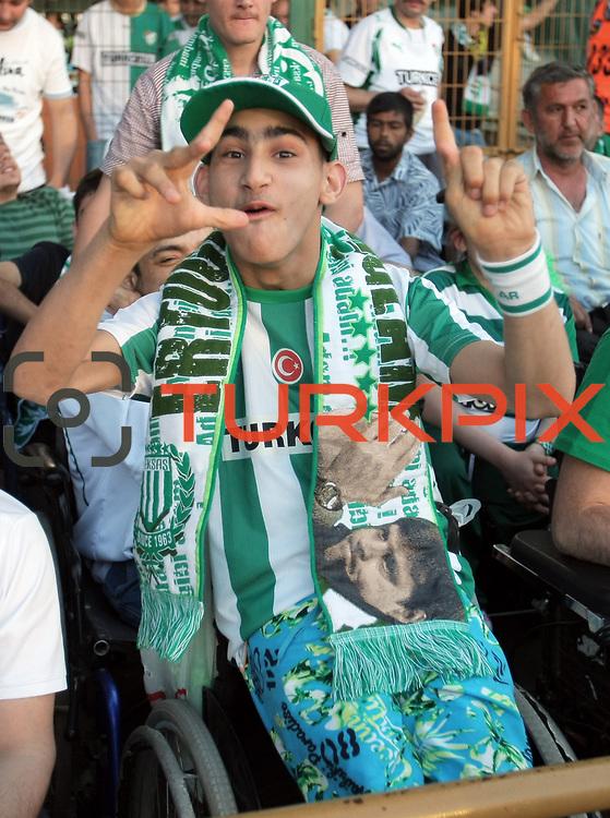 Bursaspor's supporters during their Turkish soccer super league match Bursaspor between Besiktas at Ataturk Stadium in Bursa Turkey on Sunday, 16 May 2010. Photo by TURKPIX
