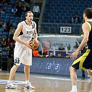 Efes Pilsen's Sinan GULER (L) during their Turkish Basketball league derby match Efes Pilsen between Fenerbahce Ulker at the Sinan Erdem Arena in Istanbul Turkey on Sunday 24 April 2011. Photo by TURKPIX